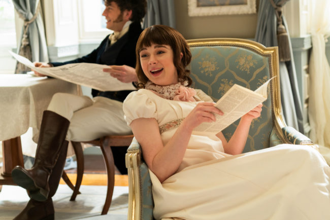 Some of the Bridgerton's reading the newest gossip and scandals in Lady Whistledown's paper.  Photo by LIAM DANIEL:NETFLIX - © 2020 Netflix, Inc.