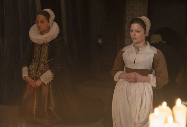 """Alicia Vikander and Holliday Grainger in """"Tulip Fever"""". Photo: Alex Bailey © 2014 The Weinstein Company."""